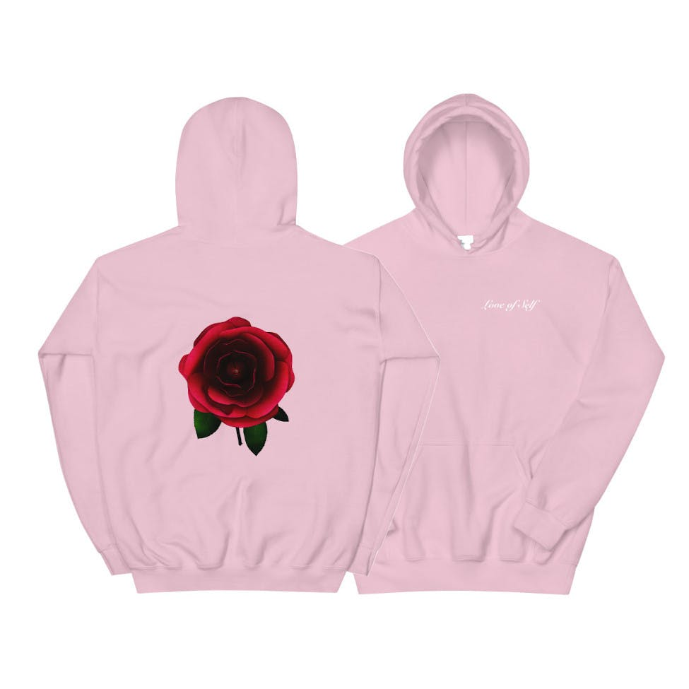 "A pastel-colored hoodie with text on the front saying ""Love of Self"" and a large rose flower on the back."